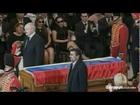 Iran Presiden Mahmoud Ahmadinejad Kisses Hugo Chavez's Coffin at his Funeral